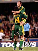Kevin Muscat and Shaun Murphy celebrate Australia's goal